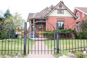metal fencing, arch top entry gate for 4-foot front yard fence with Fleur-de-lis caps and arched pickets
