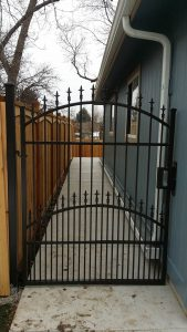 Metal gate with double arch top and spear detail. Small dog security