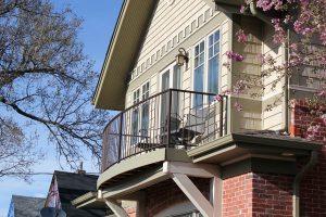 Curved, simple iron balcony railing