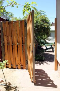 Wooden, vertical woven 1x4 pickets on steel frame, powder coated.