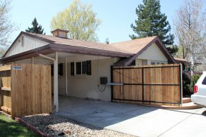 Automatic opening, single carport gate or fence with steel frame and dog-ear wooden pickets to match existing privacy fence.