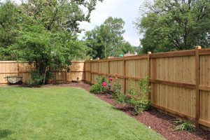 Wooden fence, tongue and groove privacy fence with contemporary beveled top
