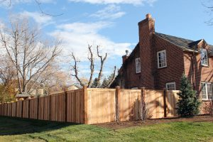 Tongue and groove, privacy fence, cedar wood fence with decorative post caps and a flat cap rail