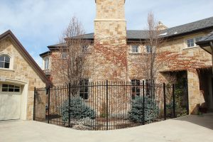 Metal, two rail, spear tip picket 6 foot steel fence with curved sections and matching gate