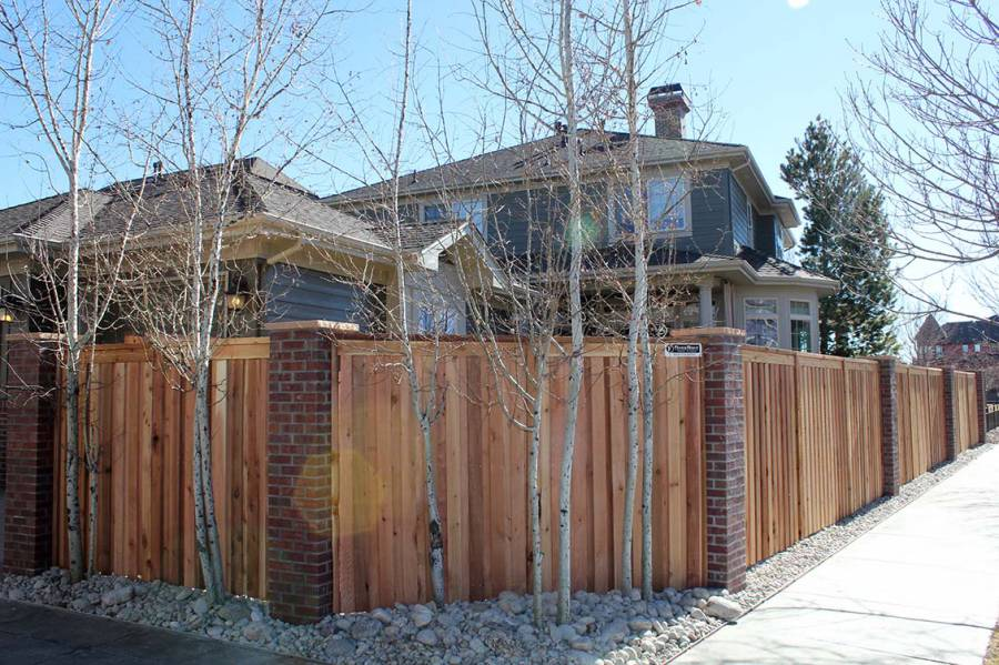 Wood privacy fence custom fit to brick column posts