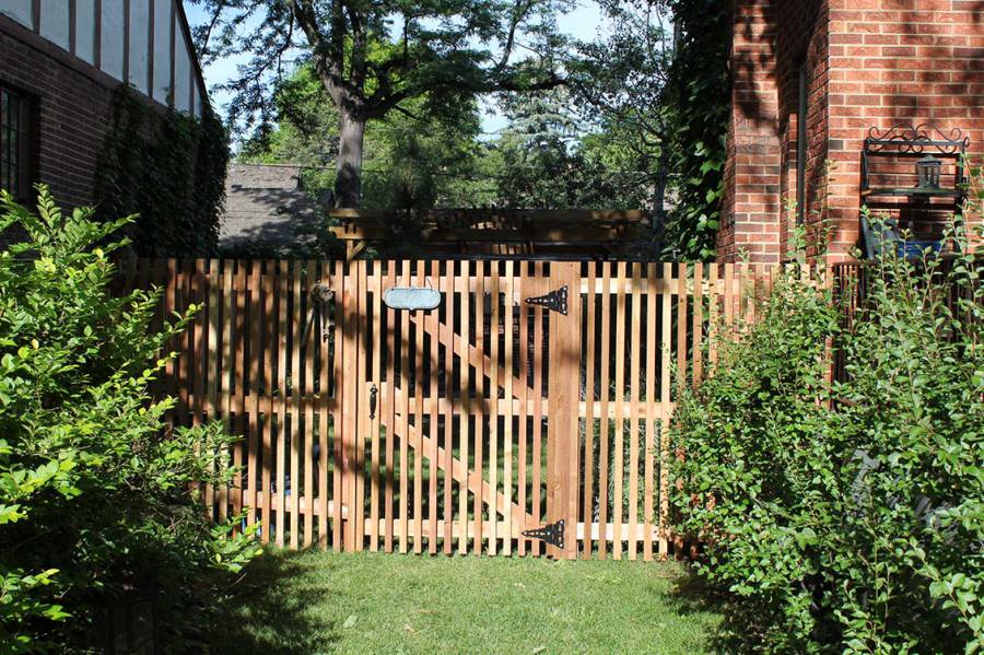 Open vertical picket fence and gate