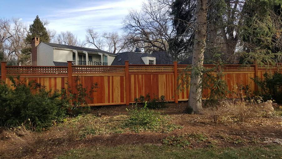 Decorative wood privacy fence with open pattern top section, cap rail and posts, Denver, Colorado