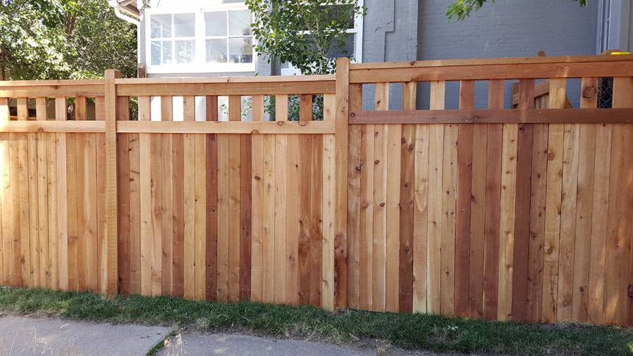 Cedar privacy fence with decorative, open pattern top section and cap rail, Denver, Colorado