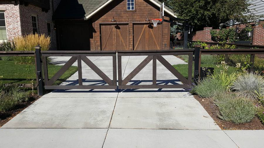 Farm-style fence with garage gate, Colorado